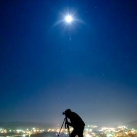 Photographer under the moon